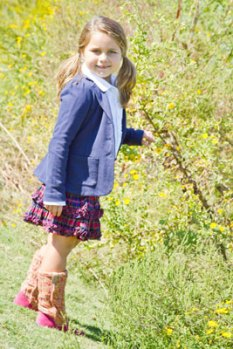 Sierra has fun in this classic schoolgirl outfit. The checkered skirt and blue blazer are by Ralph Lauren and they are paired with a white girls' button down shirt by Crewcuts Everyday. Outfit provided by Angels & Rascals.