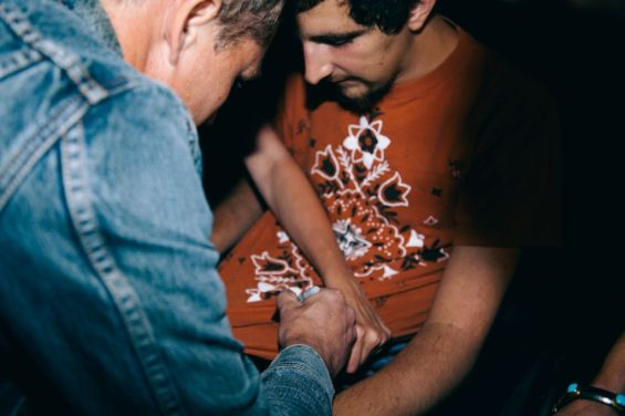 During their back-stage conversation, Fairey autographed Anthony's shirt.