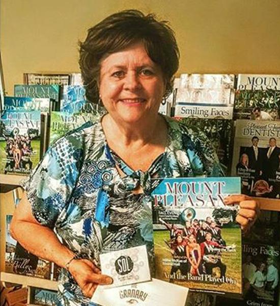 Carol Hughes winning multiple gift cards to local restaurants.