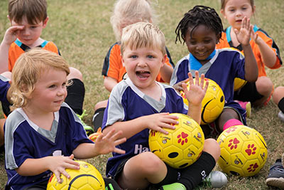Happy Feet introduces a love of soccer to youngsters with Bob, the smiley face soccer ball.