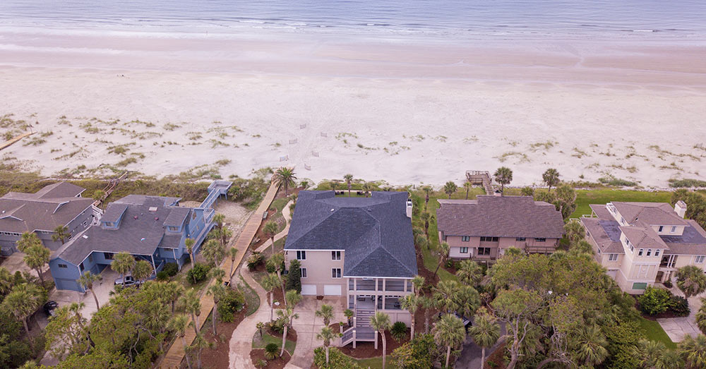 Like the beach? This photo of coastal homes should be right up your alley!
