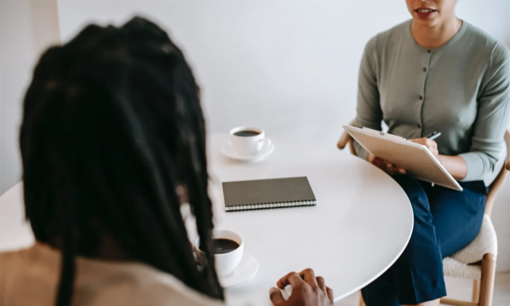 A woman talks to her friend about important documents as she prepares for her future. Preparing for the future is important, even if its difficult.