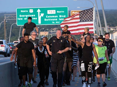 """Mount Pleasant Police Chief Richie: """"After the Emmanuel 9 tragedy, I had the honor of leading the unity walk over the Ravenel Bridge."""""""