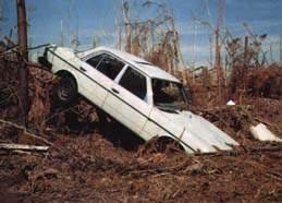 McClellanville, SC a car amidst the ruin after Hurricane Hugo