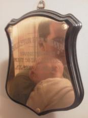Matt & Mil's reflection in one of Grandpa Elmer's plaques