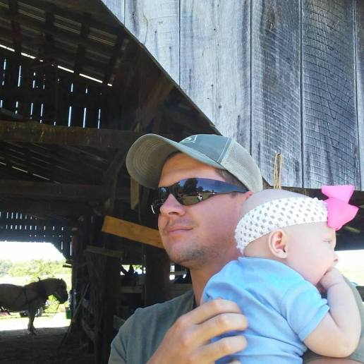 Mildred with daddy at her 1st antique tractor show.