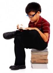 Boy sitting on Move Books