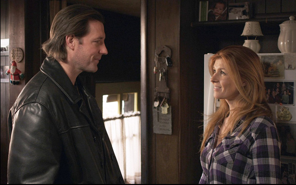 """Ed Burns and Connie Britton in a scene from """"Fitzgerald Family Christmas"""""""