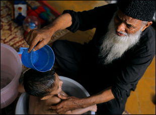 "Abdul Sattar Edhi in a scene from ""These Birds Walk"""