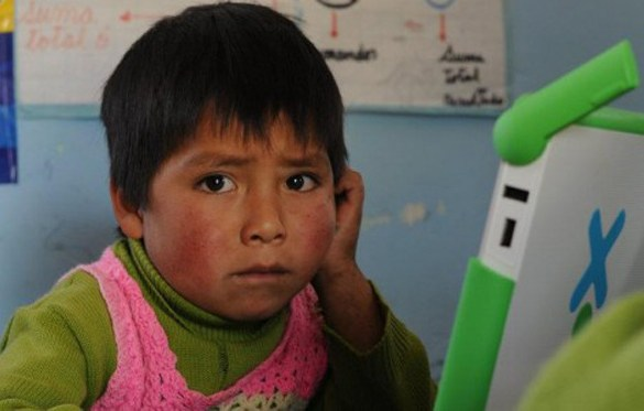 "Child in Peru looks at a laptop in Michael Kleiman's ""Web"""