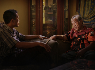 "A scene from Joshua Oppenheimer's ""Look of Silence"""