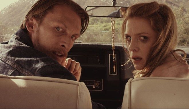 "James Landry Hebert and Ashley Bell in ""Carnage Park"""