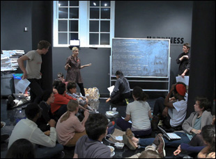 """Victoria Sobel leads a discussion at Cooper Union in Andrew Rossi's """"Ivory Tower"""""""