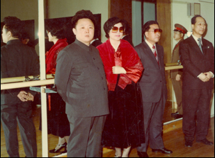 "Choi Eun-lee and Kim Jong-il in ""The Lovers and the Despot"""