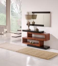 Consola em psu ferro e lacado alto brilho preto. Peças de mobiliário que transformam os ambientes.