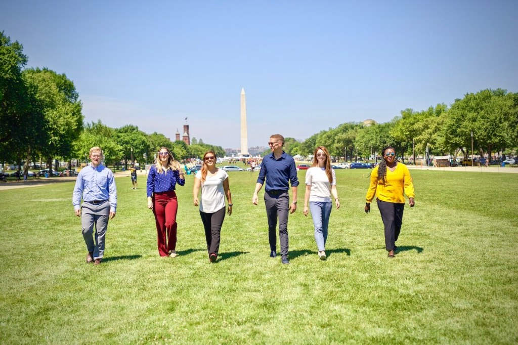 MovementX team of physical therapists walking in front of Washington Monument in Washington DC