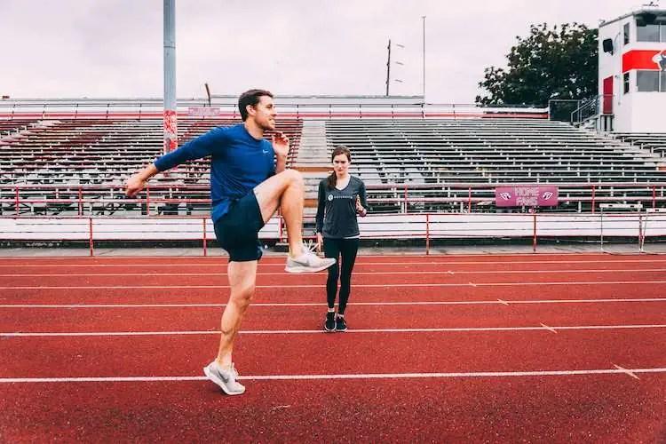 Man performing running drills on track