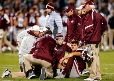 STARKVILLE, MS - NOVEMBER 23: Nick Fitzgerald #7 of the Mississippi State Bulldogs is attended to by medical staff after an injury during the first half of an NCAA football game against the Mississippi Rebels at Davis Wade Stadium on November 23, 2017 in Starkville, Mississippi. (Photo by Butch Dill/Getty Images)