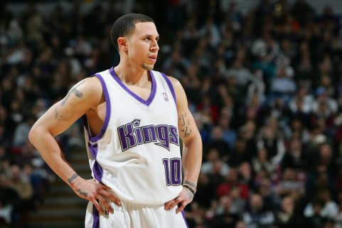 SACRAMENTO, CA - JANUARY 13: Mike Bibby #10 of the Sacramento Kings looks on against the Houston Rockets during an NBA game at Arco Arena January 13, 2007 in Sacramento, California. NOTE TO USER: User expressly acknowledges and agrees that, by downloading and or using this Photograph, User is consenting to the terms and conditions of the Getty Images License Agreement. (Photo by Jed Jacobsohn/Getty Images)