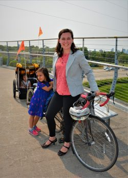 mother with daughters and bike trailer