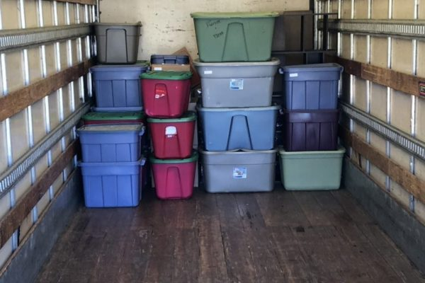 Picture of Movers and Movers started loading truck with plastic bins