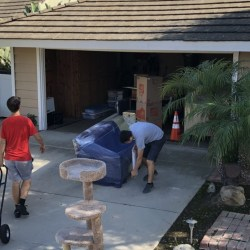 Picture of Movers and Movers covering couch with blankets and shrink wrap