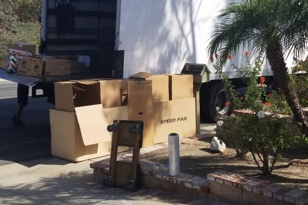 Picture of Movers and Movers arrived to drop off address and carefully parked the truck right to customer's garage