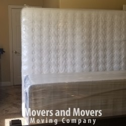 Picture of how Movers and Movers wrapped carefully mattress and box spring with shrink wrap.