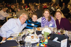 Youth Honoree Morlan Osgood celebrates with her brother and parents at the 2016 Duke Energy Difference Makers Celebration at Cincinnati Museum Center.