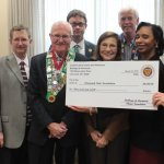 At the check presentation: (front) Cincinnati State chefs Alan Neace and Jeffrey Sheldon; Irwin and Barbara Weinberg; Cincinnati State interim president Dr. Monica Posey; and George Elliott, Bailli for the Cincinnati Chapter of the Chaîne des Rôtisseurs; (back) Elliott Ruther, Cincinnati State chief of development; and Dr. Graig Smith, an officer with the Cincinnati Chapter