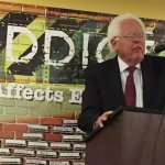 Cincinnati Vice Mayor David Mann speaks at the annual pancake breakfast about the need for more services.