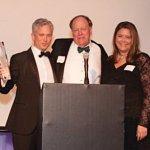 Honoree Patrick Hughes with Rick Hulefeld and Shannon Starkey Taylor