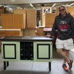 Tom Laux and the cabinet he created