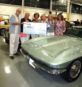 Bruce and Melanie Healy, winners of last year's car raffle, pose with committee members Julie Richardson, Kate Devine, Megan Joy and Petra Vester.