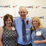Roger Grein (center) with Cindy Pilopovich and Marcia Lechner of CancerFree Kids, which has won grants from Magnified Giving students