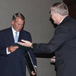 Dave Bruno hands the Spirit of Scouting certificate to John Boehner