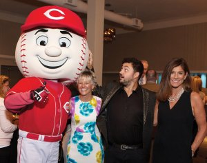Mr. Red gives a thumbs up to emcee Eli Maiman, who is joined by Dale Silver, CBC board member and Rosie Reds board president, and Karen Forgus, Cincinnati Reds senior vice president of business operations.