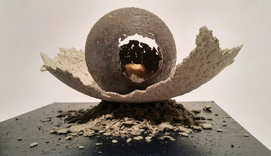 """PJ Grimm, """"Egg Formation 1,"""" Campbell County Recorder series """"Golden Age"""", 2016, paper pulp (made from the Campbell County Recorder), cement, acrylic & gold leaf on wooden base"""