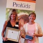 2015 honoree and CASA volunteer Joan Heckard and CASA volunteer Julie Miller, honored in 2011, accepting the award for 2016 honoree Phyllis McCallum