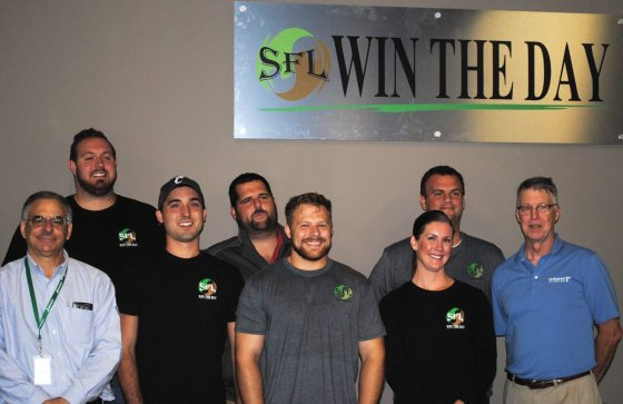 Employees of Service First Logistics, who presented the donation