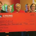 Nathan Bell, executive director, CASA for Clermont Kids; Mary Eisnaugle, vice president of marketing, Lykins Energy Solutions; Jeff Lykins, president, Lykins Energy Solutions; Tim Bettinson, owner, Cooper Blue; Margo Schwarberg, owner, Cooper Blue; and Sue Seissiger, Digimax Sign and Designs