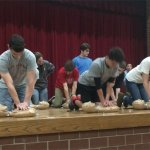 Milford High School students practice hands-only CPR.
