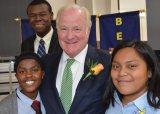 John Barrett with students Parisian and Sandra, and Noah Sherman, a 2015 graduate attending the University of Cincinnati