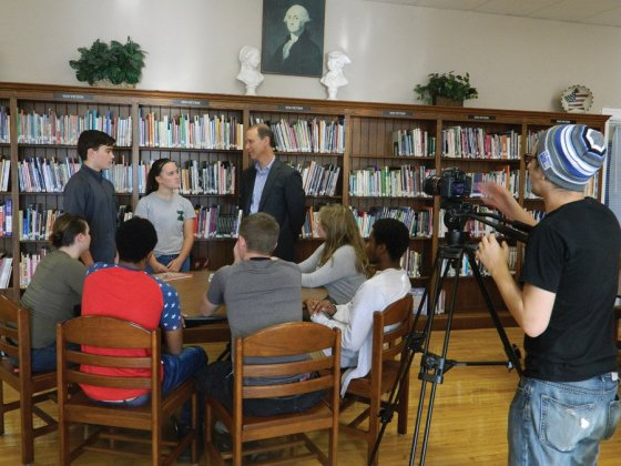 Students are filmed as they talk with Alan Abes of United Way.
