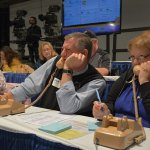 Steve Douglas from the McMillian Masonic Lodge and Anne Poppe from Summerfair Cincinnati answer phones. Summerfair Cincinnati and the McMillian Masonic Lodge are sponsors again this year.