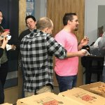 The only time the pause button on gaming got pressed? For pizza! From left: Oodle designer, Karle Goins; Beth Greiner; Brandi Goins; Oodle content strategist and copywriter, Eric House; Oodle partner and chief innovation officer, Ryan Hughes; and Oodle partner and chief strategy officer, Mark Hughes.