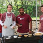 Joe Gosney, Mark Irwin, Marco Campbell and David Flauti make pancakes for neighbors visiting St. Vincent de Paul's Choice Food Pantry.