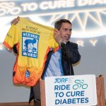 Derek Rapp holds a jersey from the first ride in 1997.