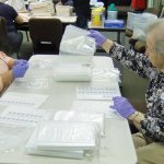 Janet Bender and Joan Mettey labeling bags