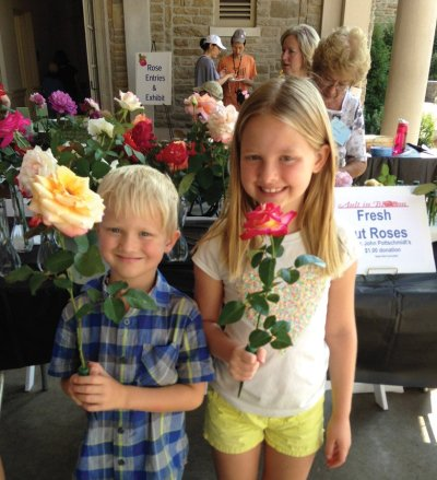 Annabelle and Graham Freeman choose cut roses for their mom.